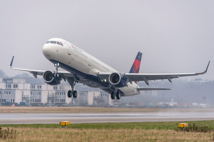 A Delta A321 taking off from the runway