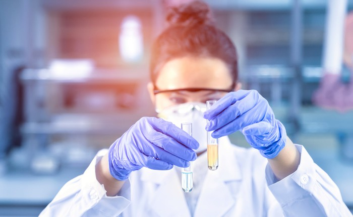 Female scientist holding two test tubes