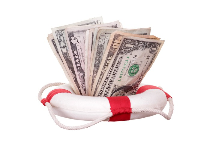 We see a life preserver full of cash.