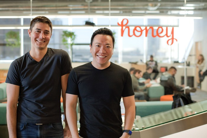The two founders of Honey standing in their office