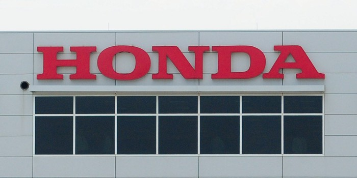 A Honda sign on the outside of a factory