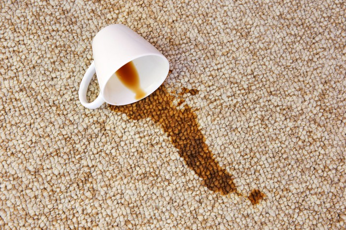 Spilled coffee on a rug.