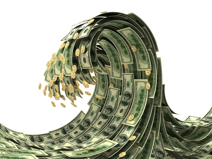 A tsunami wave graphic with dollar bills and coins as the waves.