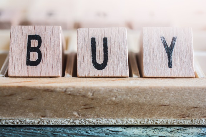 Wooden blocks forming the word Buy
