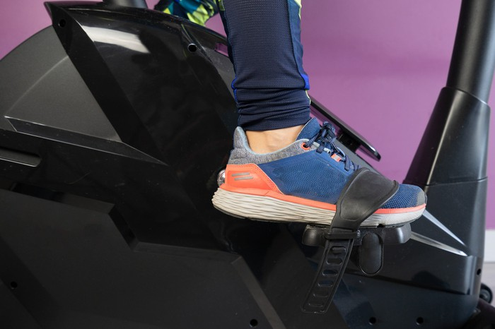 Woman's feet in the pedals of an exercise bike