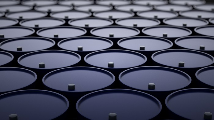 A large group of oil barrels.