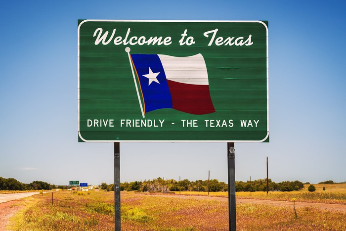 Road sign reads Welcome to Texas, Drive Friendly the Texas Way