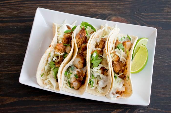 Tacos in a rectangular dish.