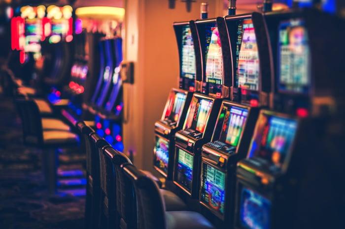 Slot machines on a large casino floor.