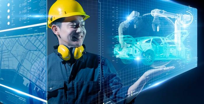 Factory engineer using virtual tools to plan manufacturing flow.
