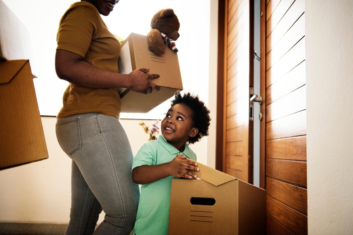 Cute kid helping his family move in.