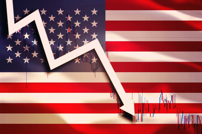 A falling white arrow on the background on the flag of the USA.