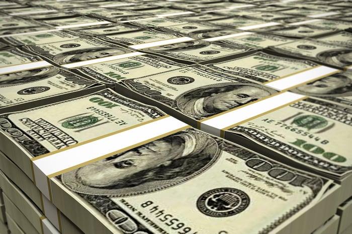 A big stack of hundred dollar bills.