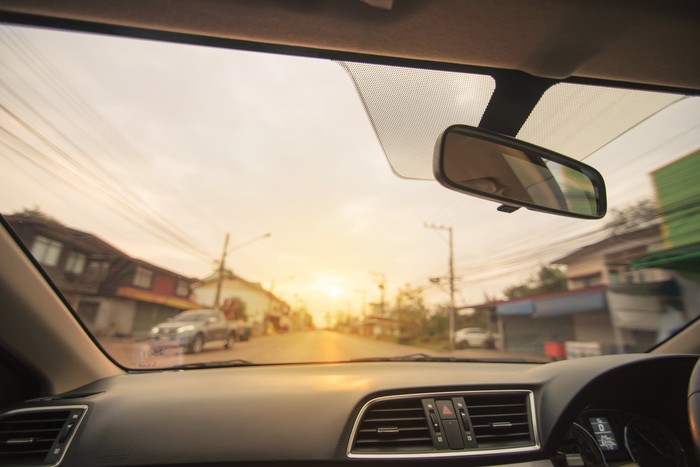 A view of a neighborhood from inside a car.