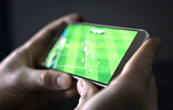 fan watching sports on smartphone