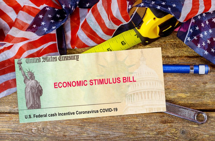 Paper the size of a check with U.S. Treasury economic stimulus bill printed on it