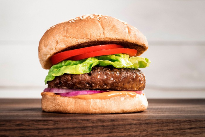 A Beyond Meat burger sits on a countertop