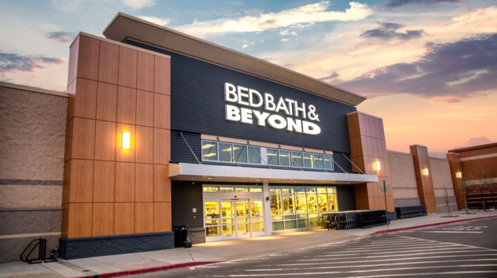 A Bed Bath & Beyond storefront, with an empty parking lot.