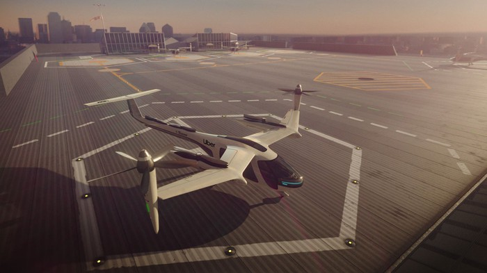 Rendering of a prototype Uber Elevate flying taxi on a rooftop helipad