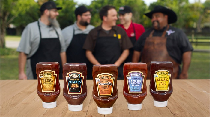 Kraft Heinz's BBQ sauce line, with a group of chefs in the background