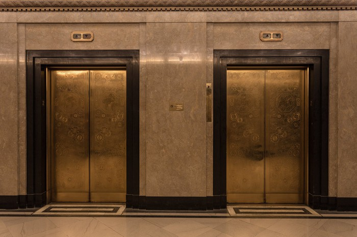 The doors of two high-end elevators.