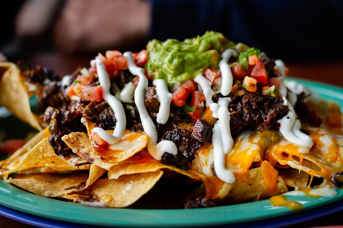 A plate of loaded nachos.