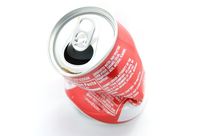 Slightly crumpled Coke can.