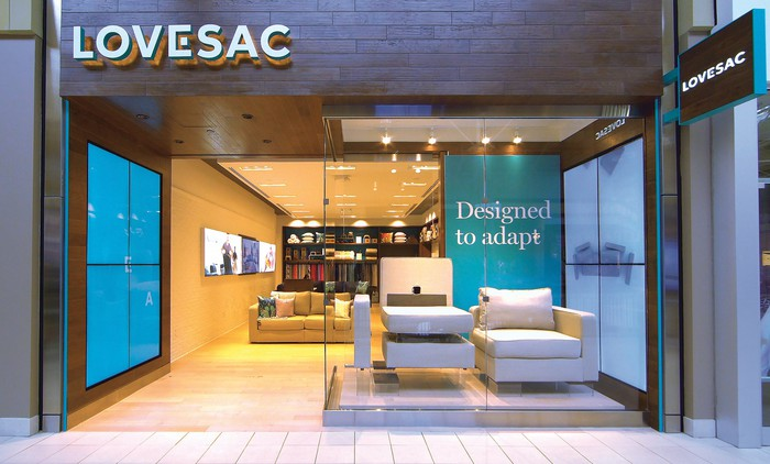 Exterior shot of a Lovesac showroom with Sactional pieces on display.
