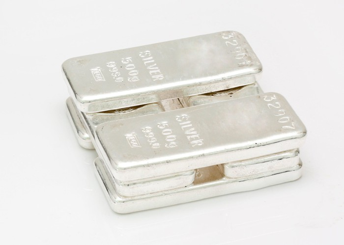 Several silver bars stacked on top of each other.