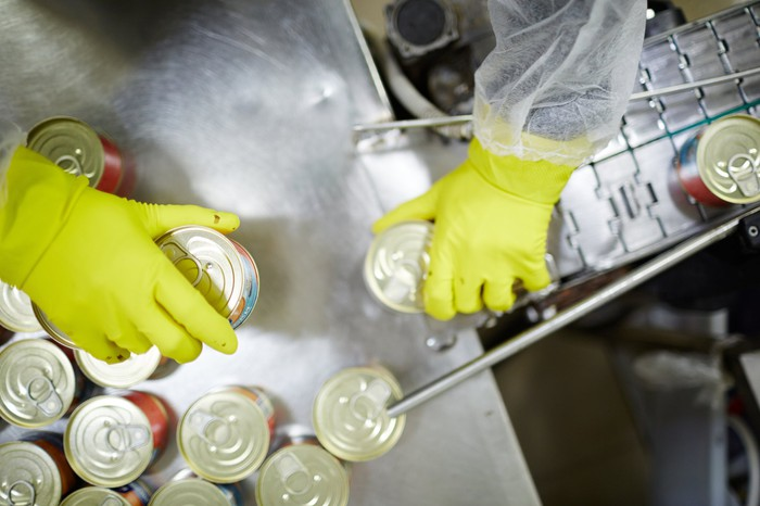 Canned food being processed.