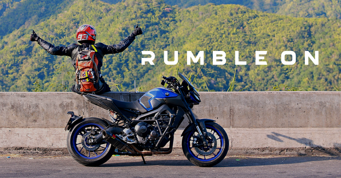 "Motorcycle rider next to ""RumbleON"" text, with a motorcycle in the foreground"