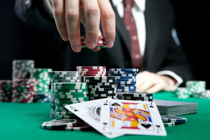 A gambling table with cards and chips.