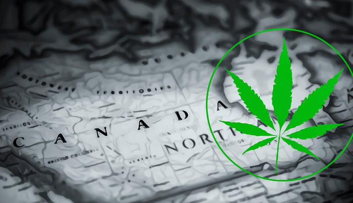 Cannabis leaf in a circle on a background of a map of Canada.