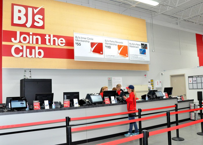 Inside a BJ's Wholesale Club location, with a sign inviting new members to join.