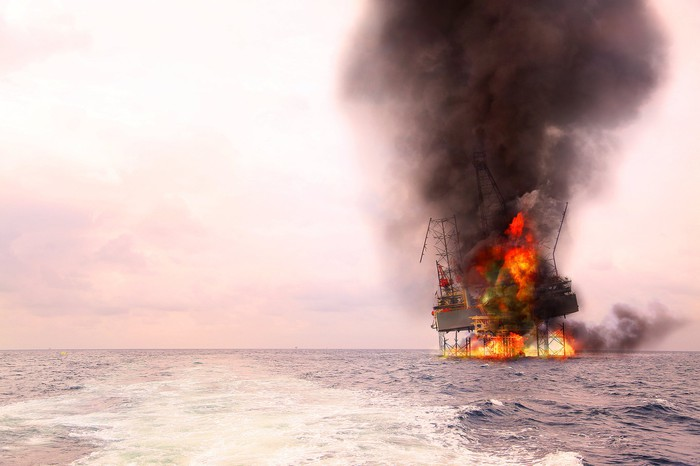 An offshore oil rig on fire.