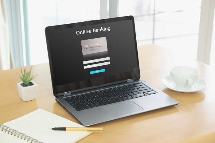 """On open laptop showing a log in page with the words """"online banking"""" at the top."""