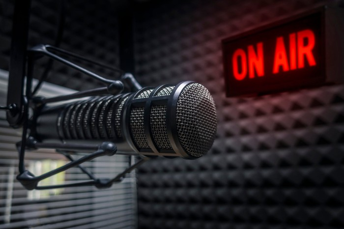 "Radio microphone and ""on air"" sign in a studio"