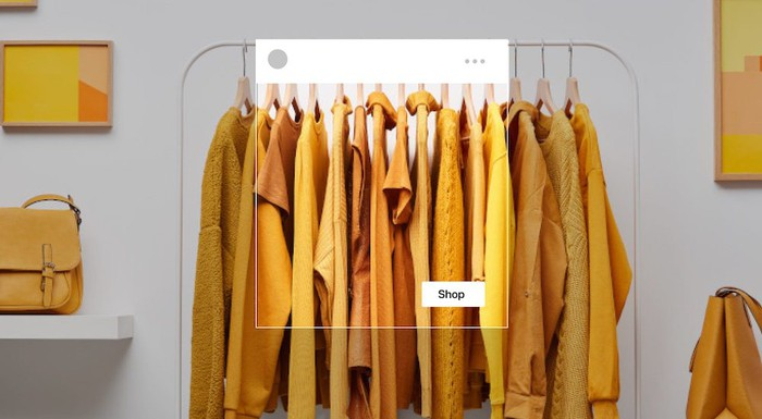 """A bunch of yellow dresses on hangers, highlighted with a """"shop"""" box to show how they'd look in Facebook Shops"""