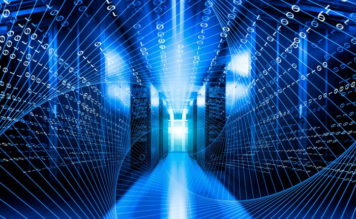 swirling lines overlaid over the picture of a data center hallway looking down between two walls of servers.