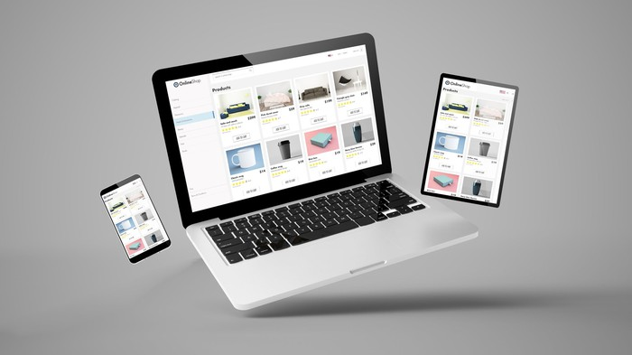 A laptop tablet and phone side by side opened to an e-commerce shopping site.