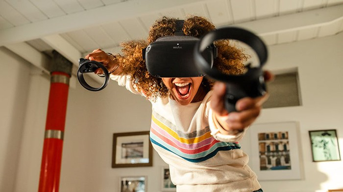 Woman using Oculus Quest headset at home.