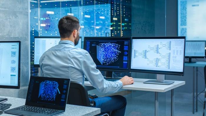 Scientists creating neural network on desktop.