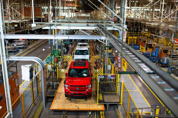 The factory's assembly line, with pickup trucks moving along.