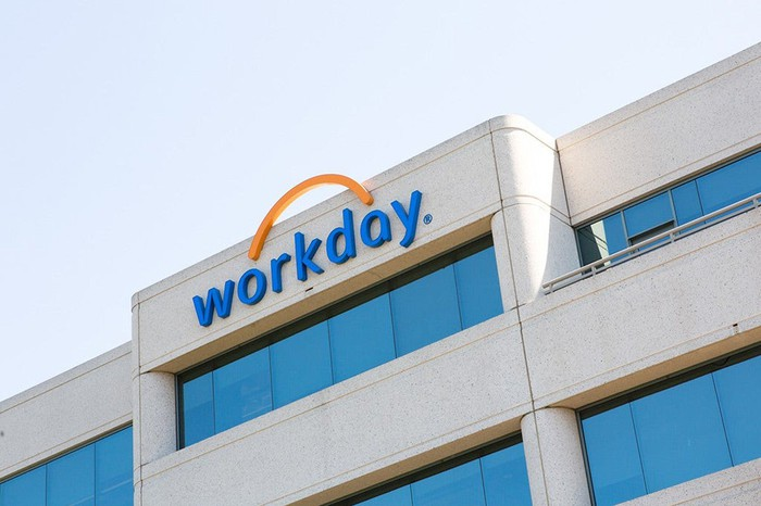 Side of office building with Workday logo on the top floor.