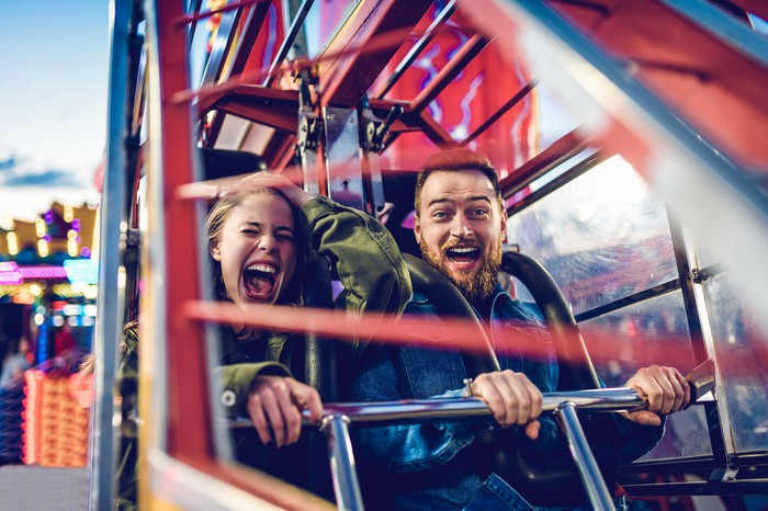 People on an amusement park ride.