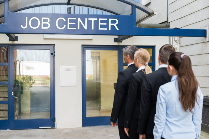 People  lined up outside a job center