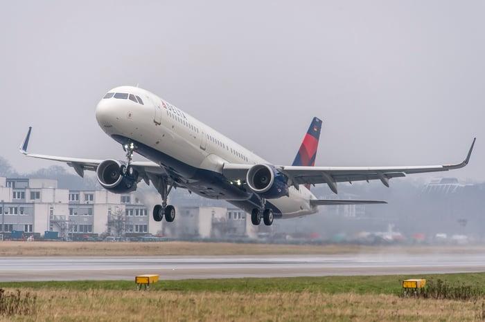 A Delta jet landing at an airport.
