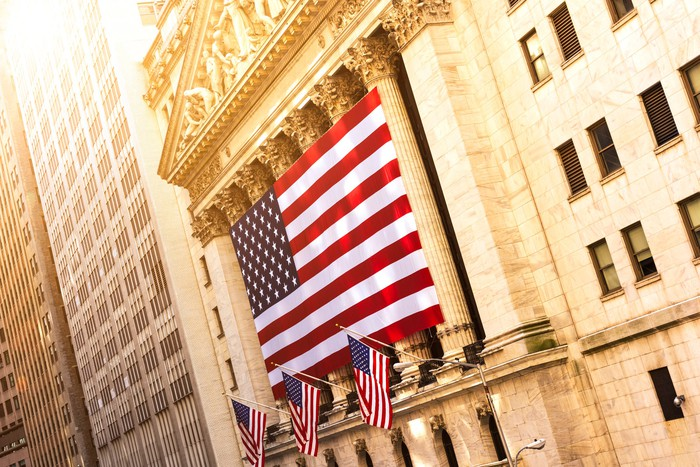 A giant flag draped in front of the New York Stock Exchange