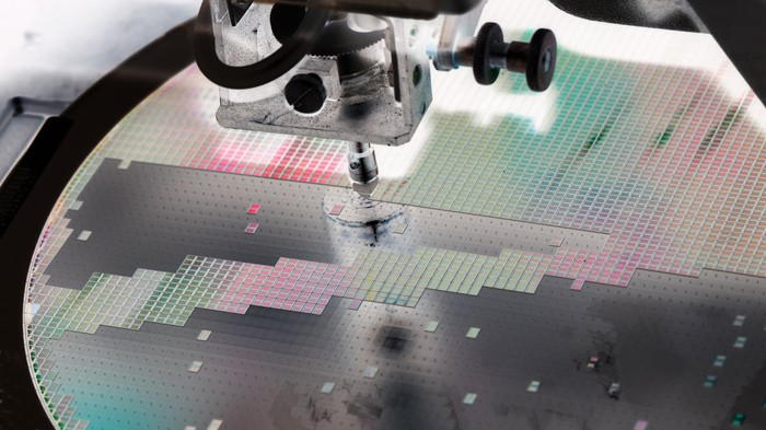 Semiconductors being manufactured on a wafer.