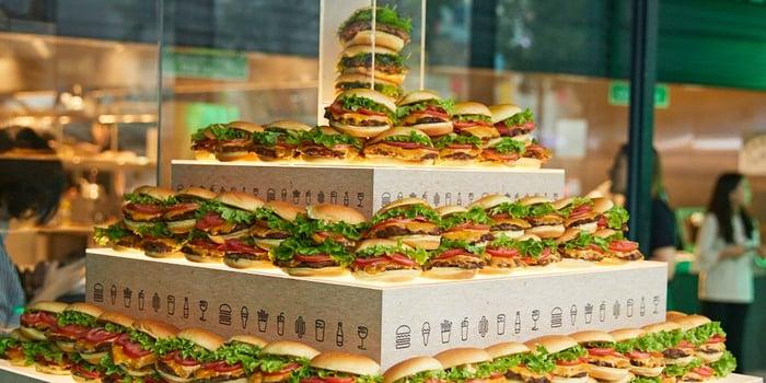 A tower made of Shake Shack hamburgers.